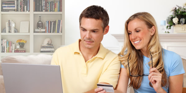 Two Homebuyers looking online for services