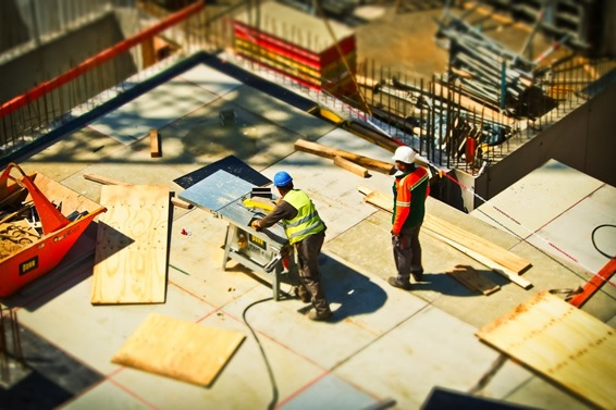 Workers constructing a home