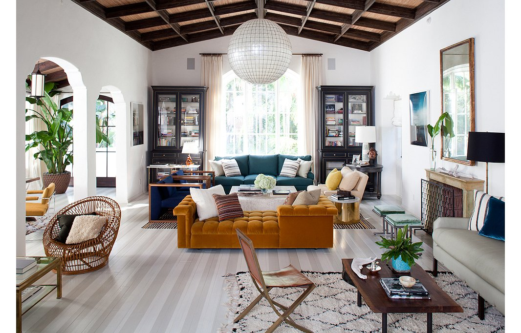 The white walls in this gorgeous living room, designed by Sasha Adler and Lauren Gold, provide a clean backdrop for its colorful furnishings.