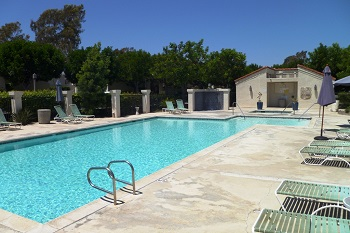 Relax by the Rancho San Joaquin community pool and spa