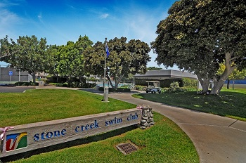 The Stone Creek Swim Club and tennis courts are close by