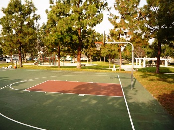 There are two basketball hoops in the park