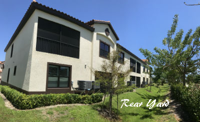 Rear Yard Photo of 1818 Parkway Condominium - condos for sale Cape Coral