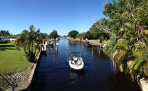 Boating on one of Cape Coral's Yacht Club Canals