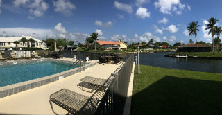 Relax in the pool near the waterway at Cape Regatta Condo