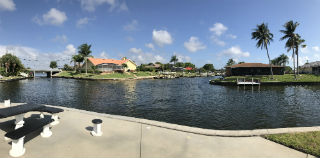 Poolside at Cape Regatta Condo on gulf access canals