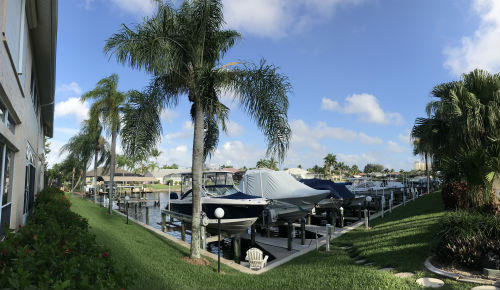 Boats on their lifts at Capstan II Condo Cape Coral