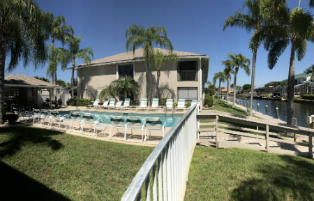 Pool overlooks the gulf access canal at Dockside Condo Cape Coral