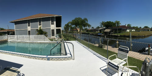 Pool overlooking the waterfront at Kimberly Bay Condo in Cape Coral