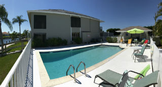 Grab a lounge chair at the community pool at Searay Condo