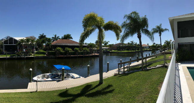 Boat at the community dock at Searay Condo Cape Coral