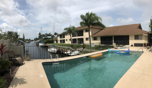 Pool and Canal view at Sorrento Court Condo Cape Coral