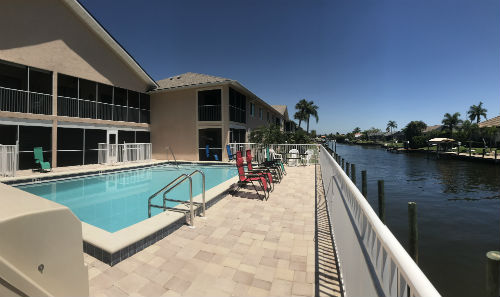 Pool overlooks Gulf Access Canal at Villa De Vern Cape Coral