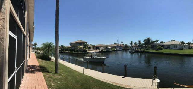 Boat cruising by the Villa De Vern Condos in Cape Coral