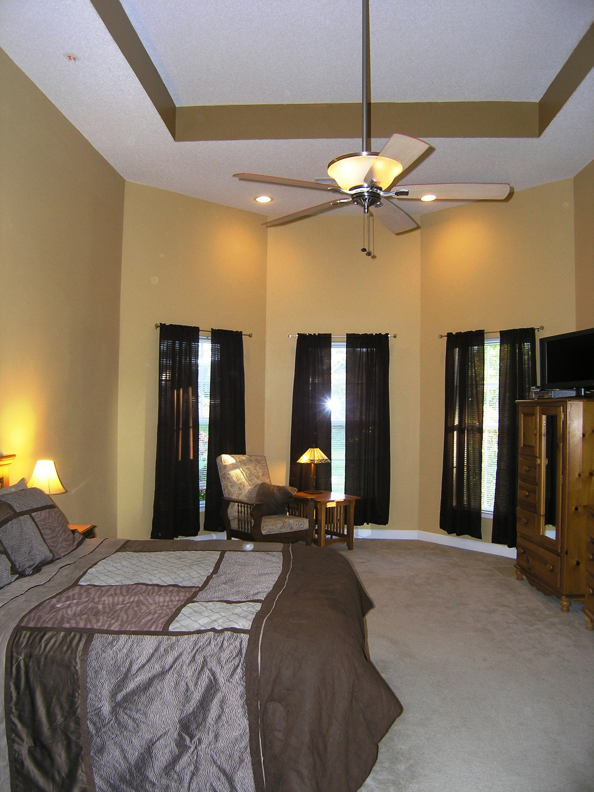 The master suite on the main floor is huge with 2 walk in closets jacuzzi tub tiled shower for 2 and a water closet