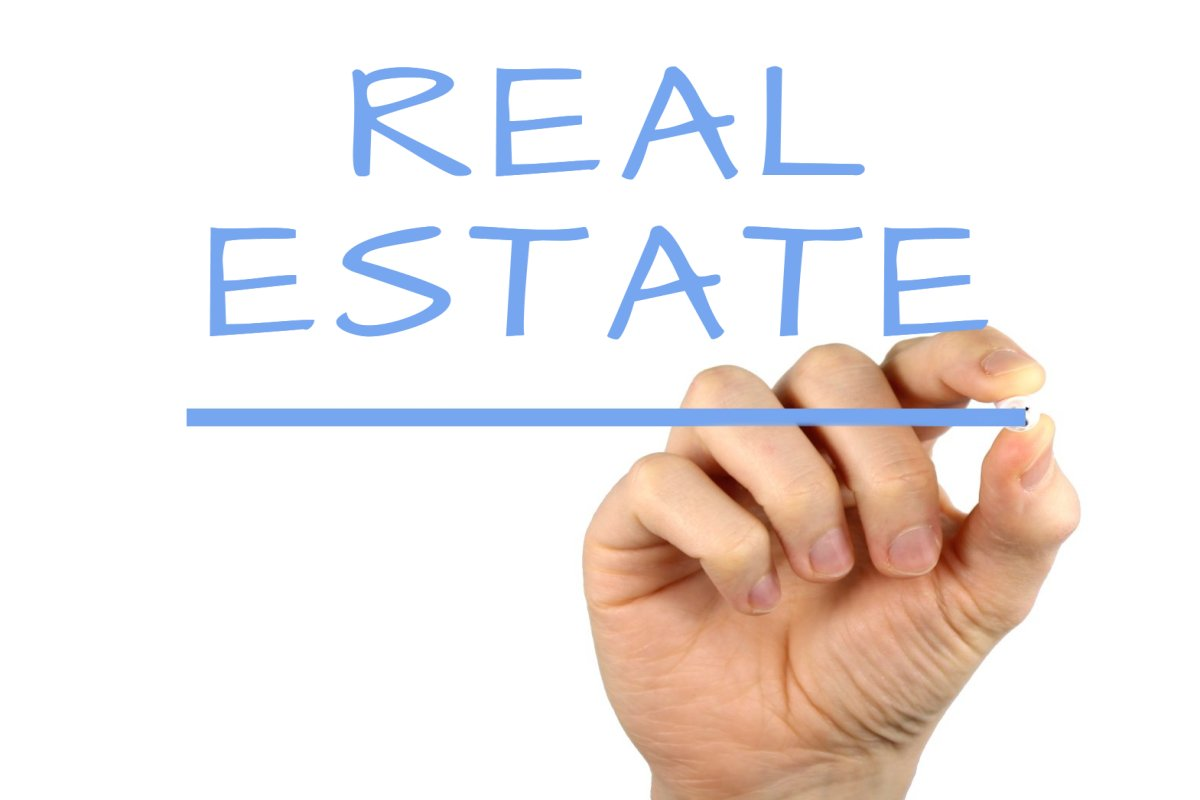 REAL ESTATE written with a marker