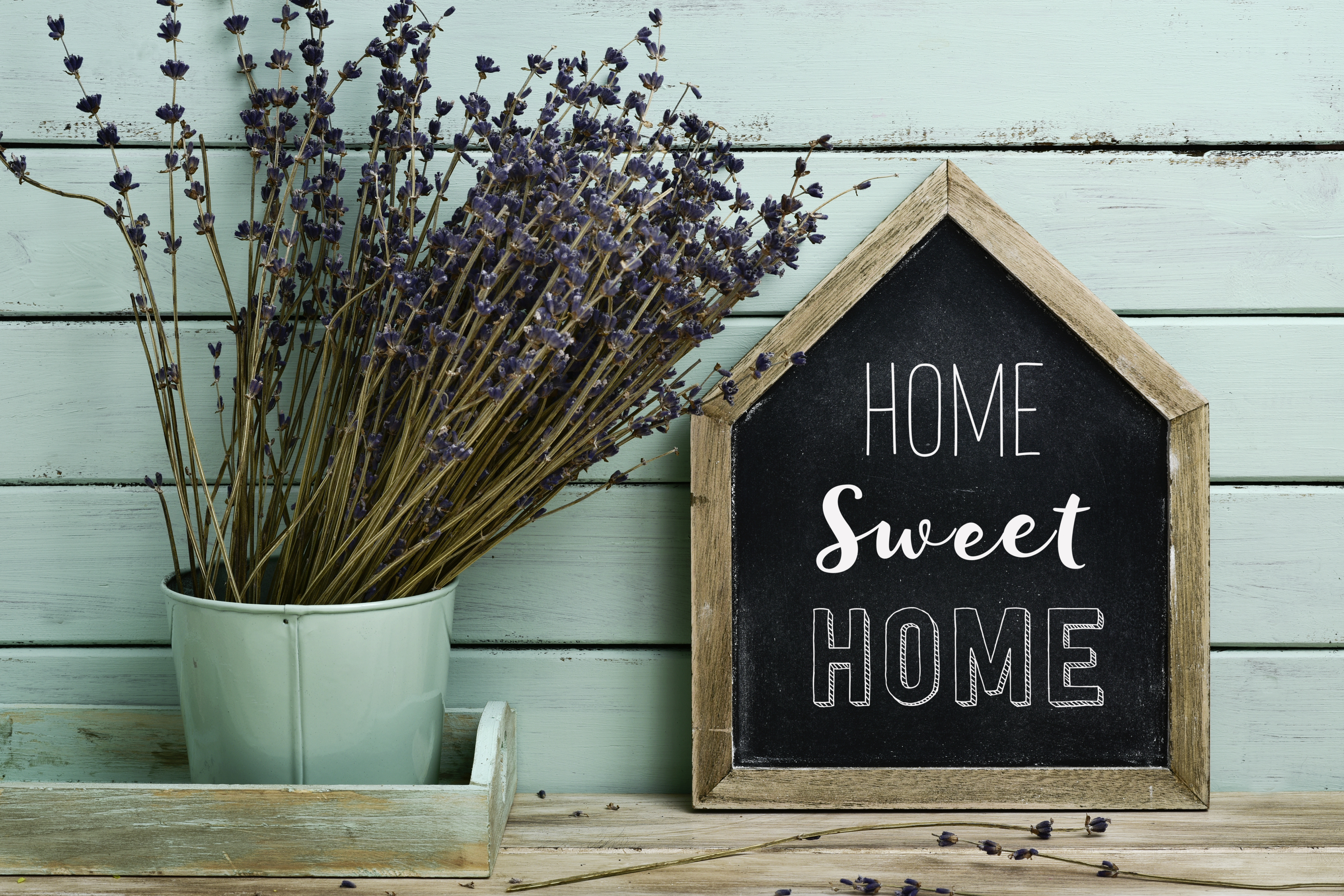 Home sweet home sign next to a bouquet of lavender