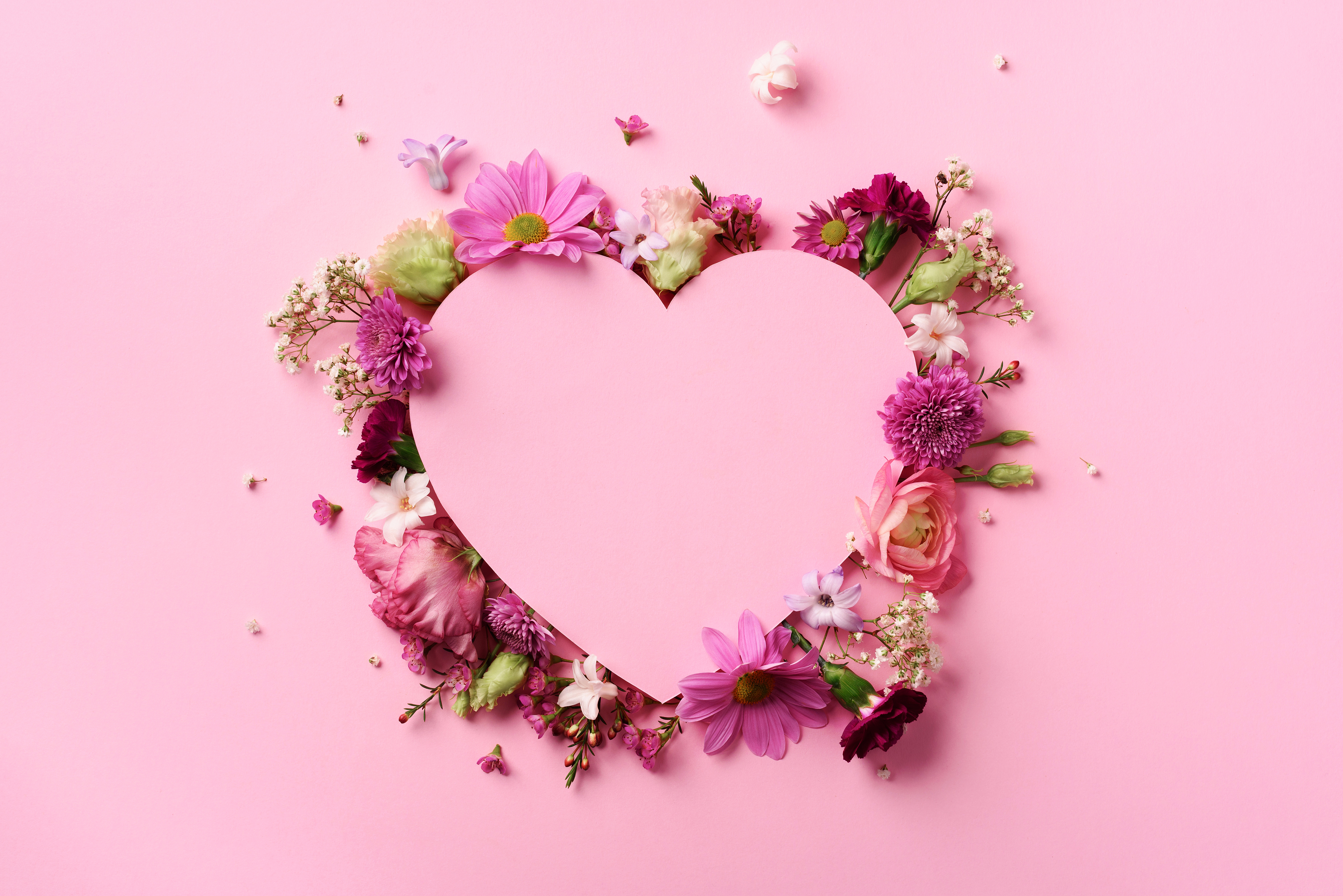 Pink Heart surrounded by flowers. Symbolizing embracing nature and spring rituals during valentine's day.