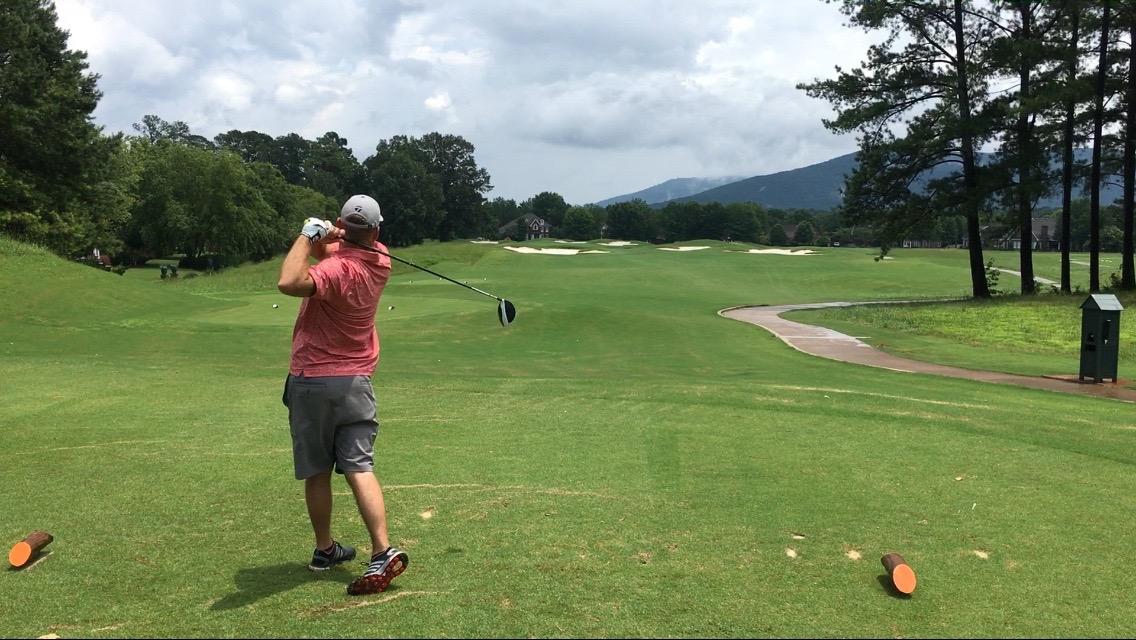 Ryan Koenig of MAKING DREAMS Realty golfing