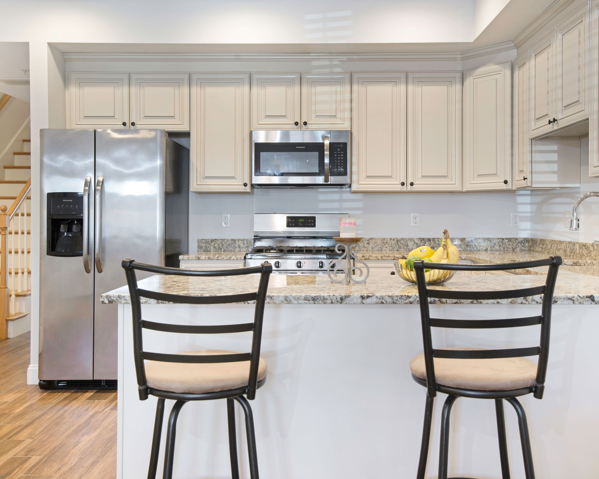 breakfast bar leads to kitchen in Haverhill MA Condo for sale