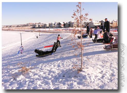 Snow sledding at Central Park in Stapleton