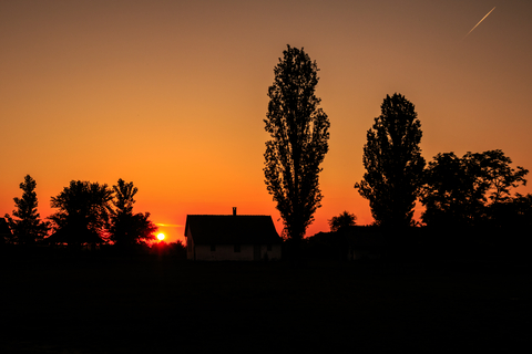 Sunset over house