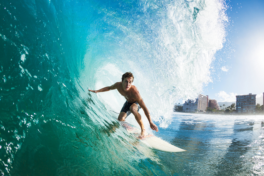 Learn to surf near Waianae luxury homes.