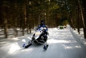 Riding snowmobiles at Lake Petenwell