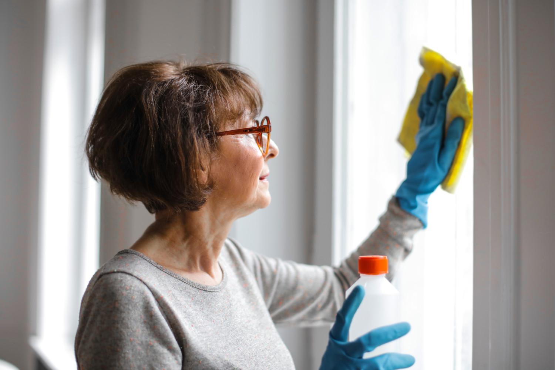 woman washing mirrors