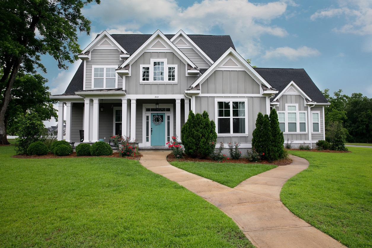 attractive gray house with pretty green grassy yard