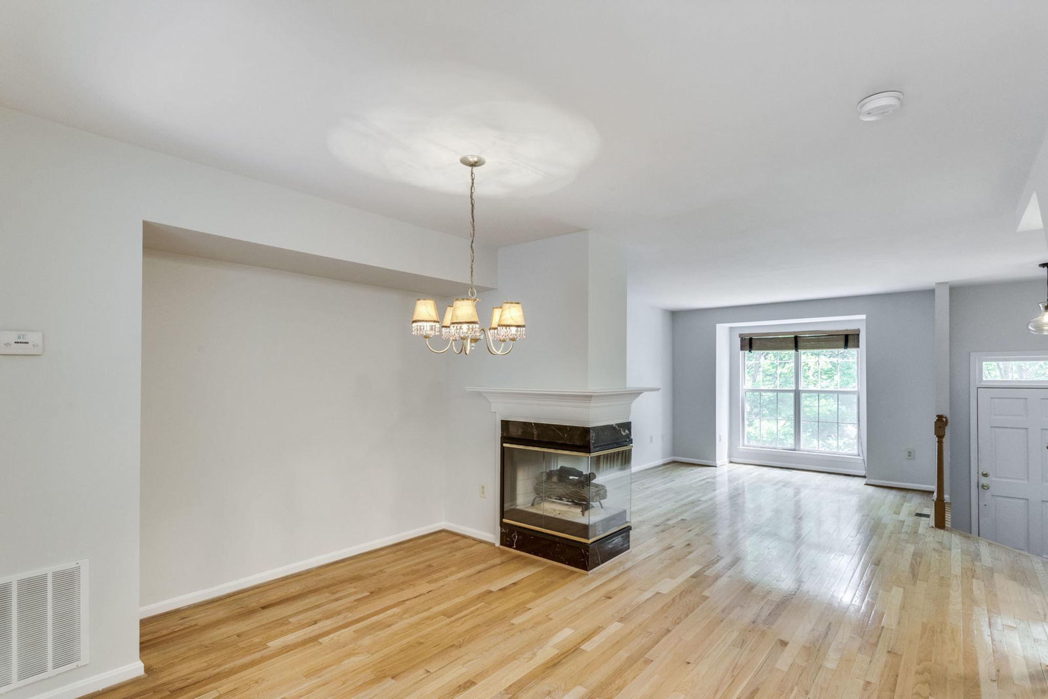 Gleaming hardwood, box bay, 3-sided fireplace!