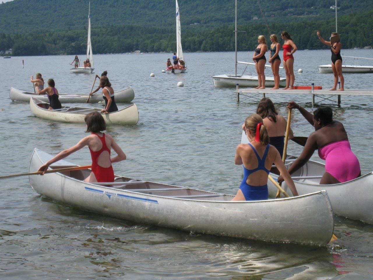 girls canoeing at summer camp