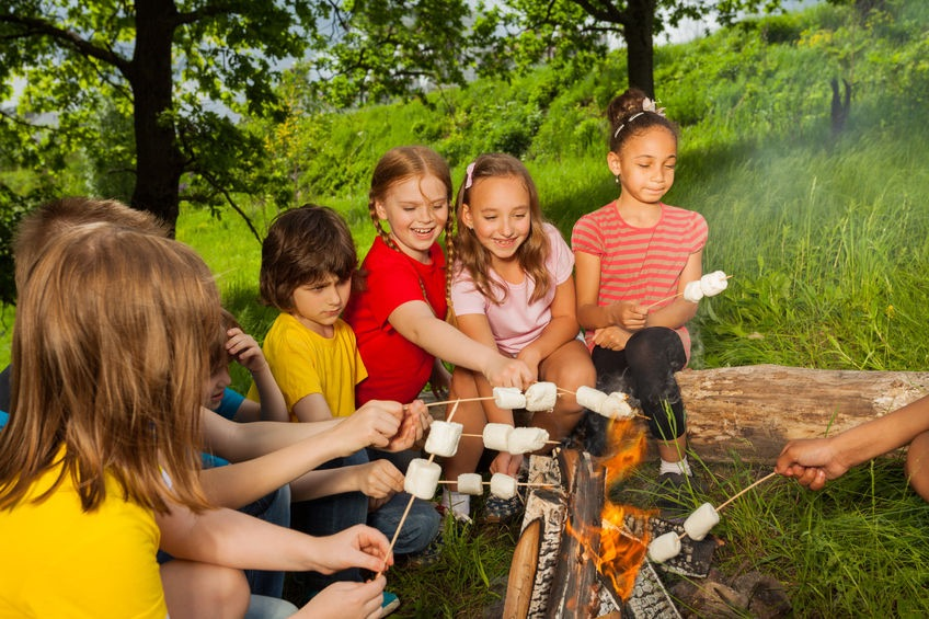 kids roasting marshmallows at summer camp