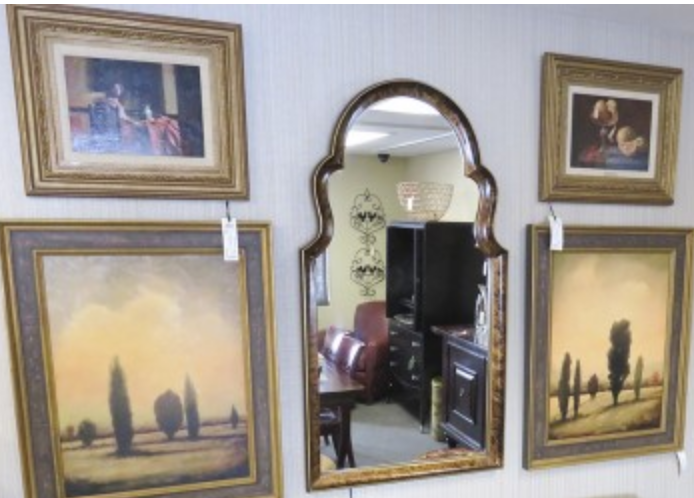 Paintings and mirror at furniture consignment store