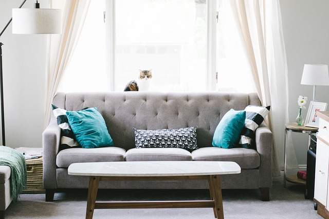 Choose to use pops of colors in pillows and candles versus painting entire walls a bold shade.