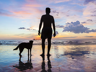 Image of Man and Dog on Beach
