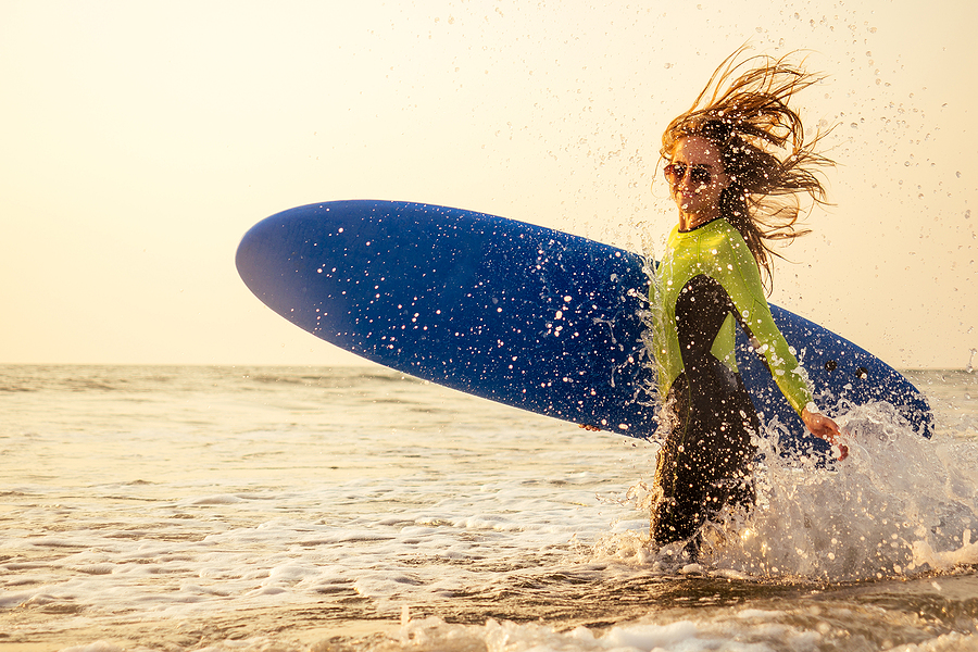 Learn to surf near your Newport Beach home.