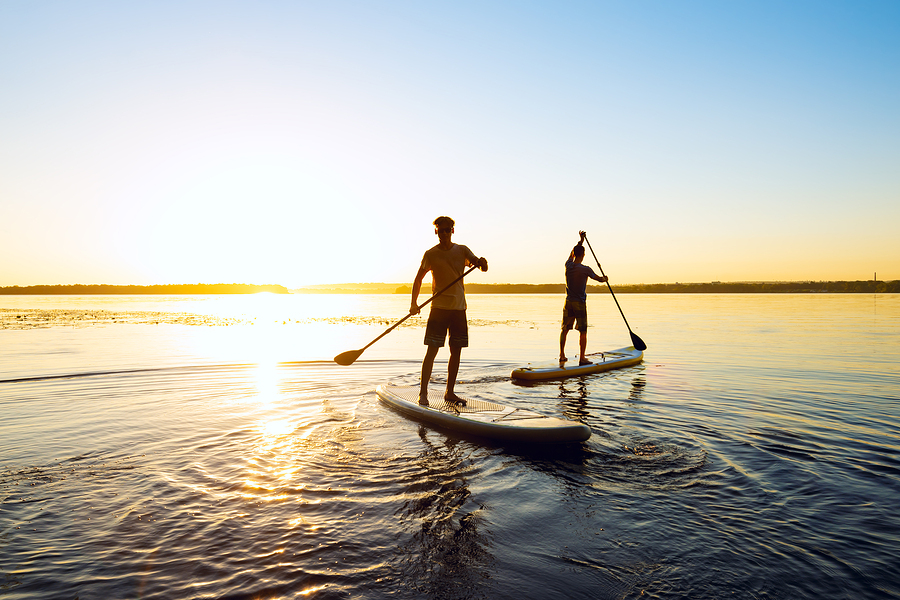 Newport Beach real estate owners go paddle boarding.