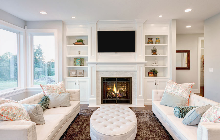 white themed living room with fireplace