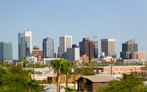 Phoenix downtown skyline with palm trees and houses