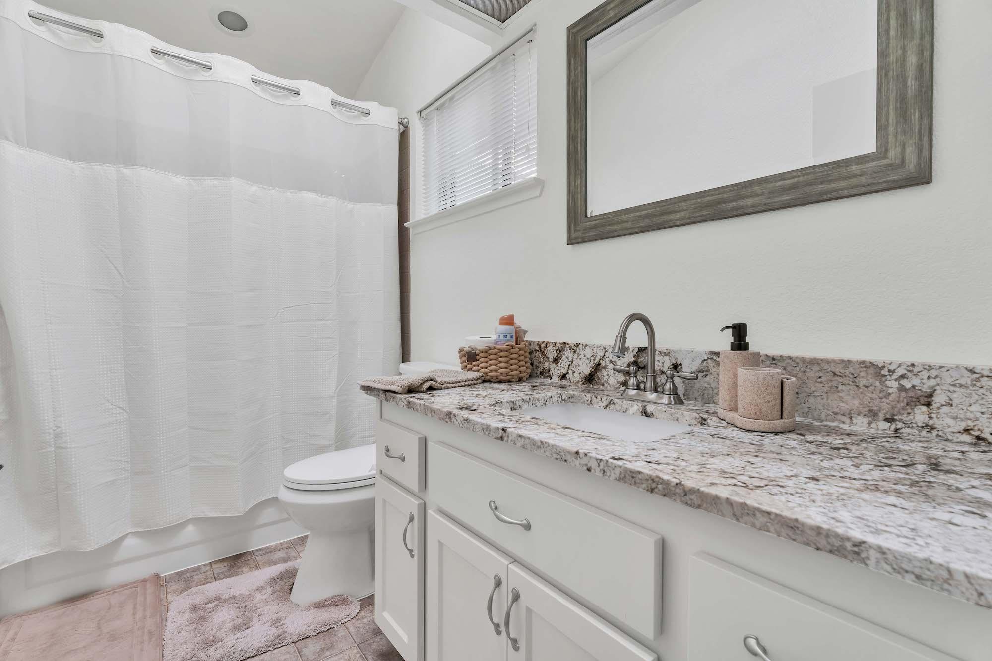 Hall bathroom of home at 7121 Heather Tree Dr, Sacramento Ca