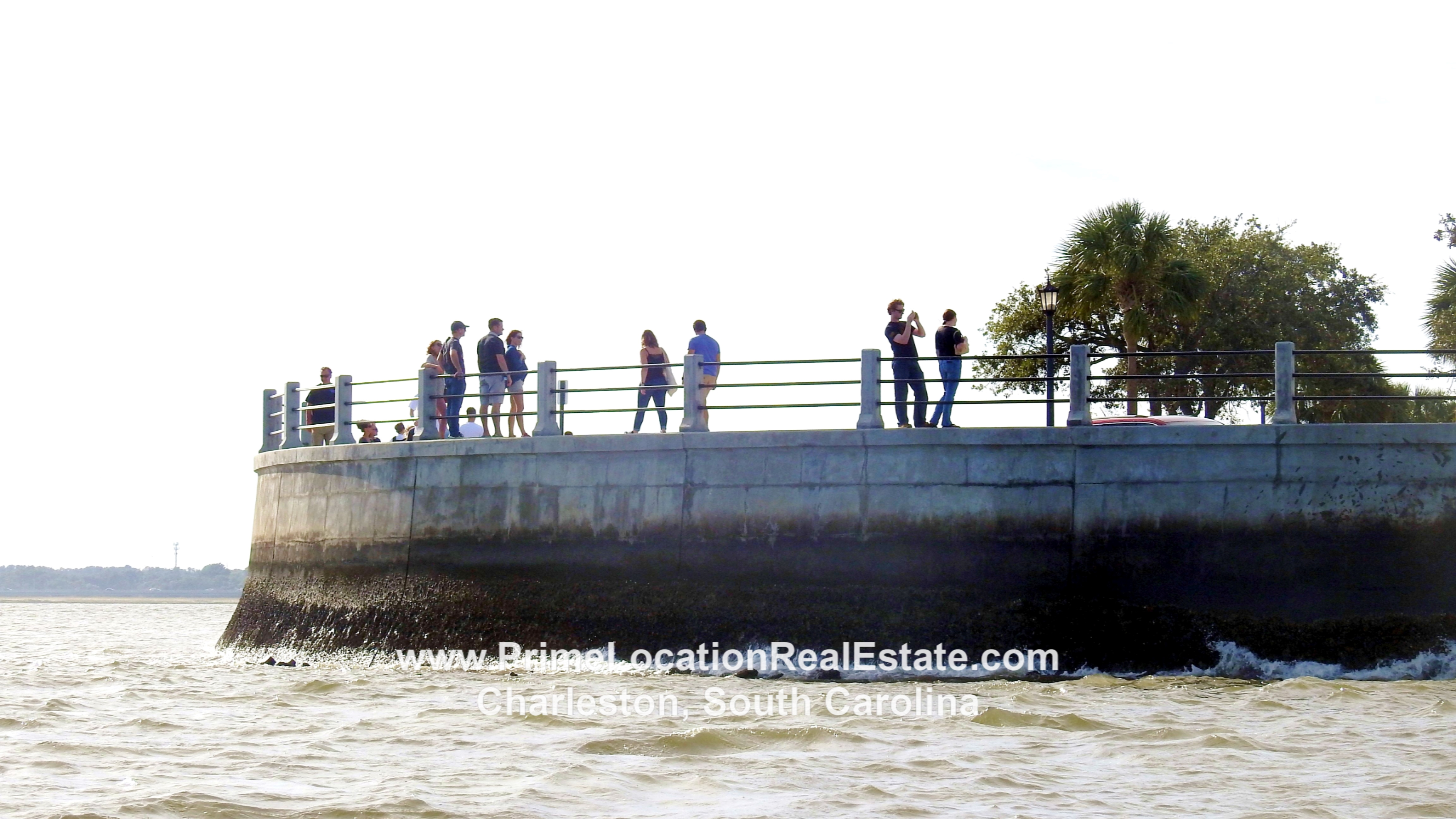 People walking along Charleston Battery Charleston SC