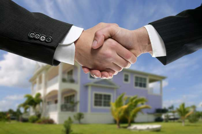 Real Estate agent shaking hands
