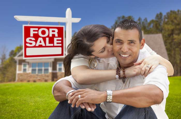 FSBO For Sale By Owner with happy couple