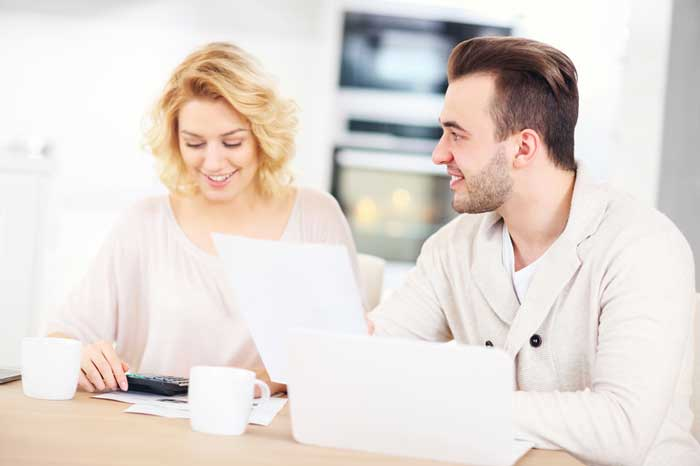 Young couple working on Rexburg ID Home Loan