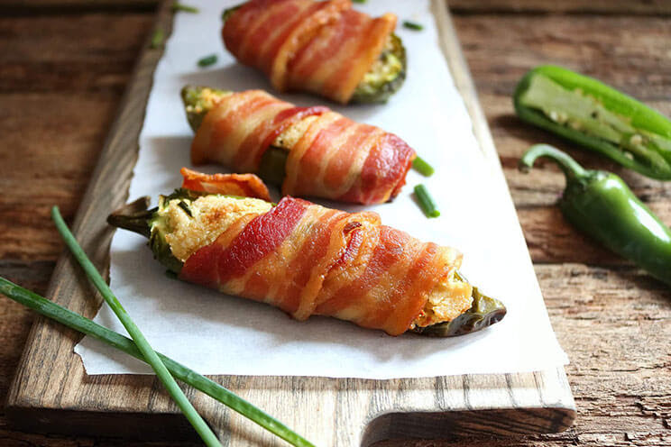 Jalapeno poppers wrapped in bacon for superbowl snacks