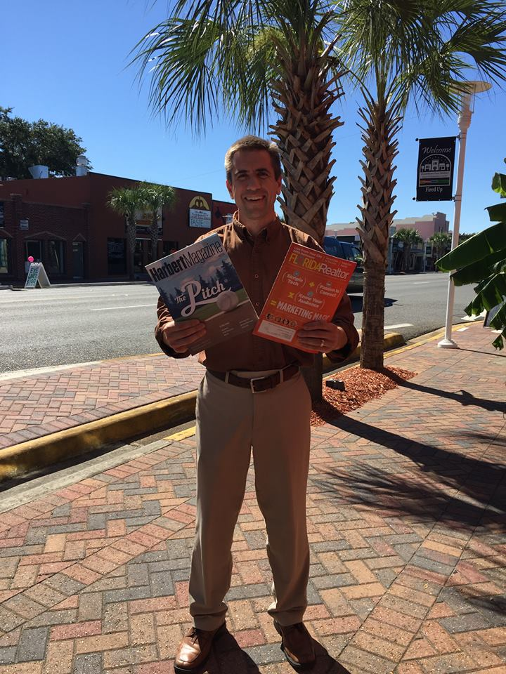 Rob Brooks holding two magazines he was featured in