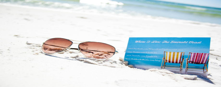 Sunglasses and Business Card in the sand