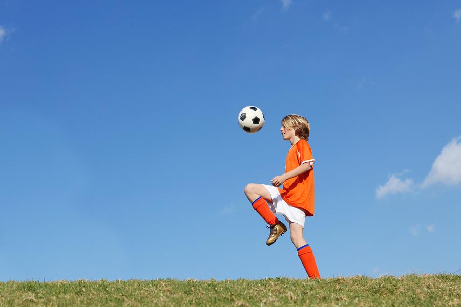 Kids play soccer near Alamo Ranch homes.