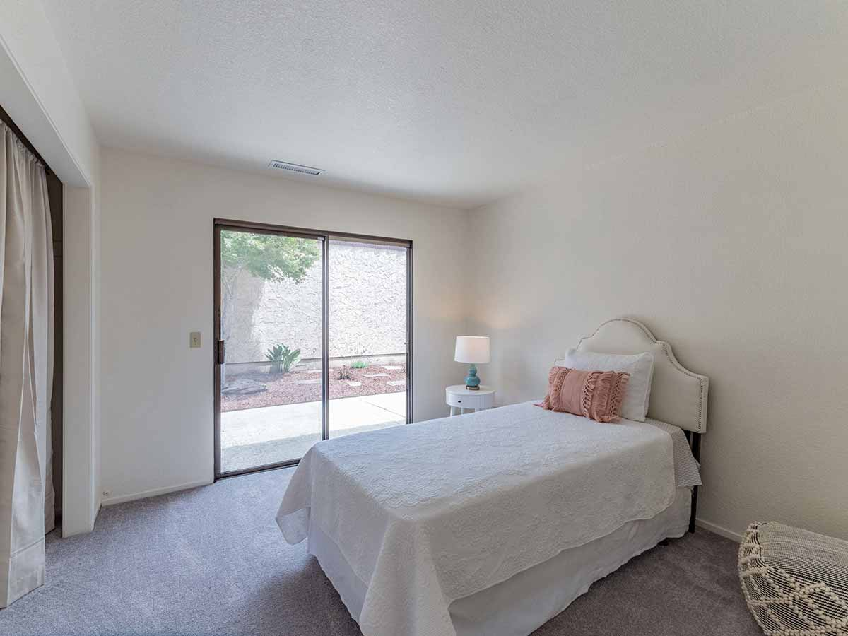 large bedroom with patio